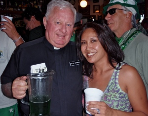 priest enjoying green beer
